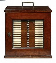 AN ENGLISH MAHOGANY AND BRASS MOUNTED MICROSCOPE SLIDE CABINET, C1900
