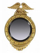 A VICTORIAN GILTWOOD CIRCULAR MIRROR, LATE 19TH C  with convex plate a