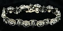 18 kt w.g. and diamond floral openwork tennis