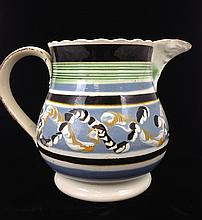 Mocha earthworm decorated jug with green insized