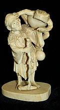 Carved ivory man w/ large toad, ht. 3.25