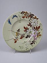Edmond LACHENAL (1855-1930)  Plat en faience à décor de papillons survo