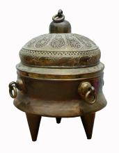ASIAN PIERCED BRASS HIBACHI WITH ELEPHANT DECORATION.