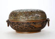 A dragons and phoenixes carved handwarmer, Qing Dynasty or later