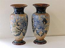 A pair of Doulton Lambeth stoneware vases with foliate decoration