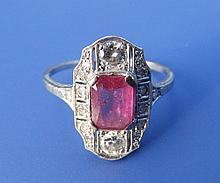 A ruby & diamond set white cluster style panel ring
