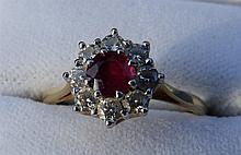 A ruby & diamond cluster ring on 18ct yellow gold shank