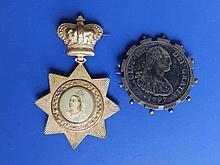 A Spanish 1797 mounted coin 'From the wreck of the Lutine, 1799' and a Victorian Diamond Jubilee badge  (2)