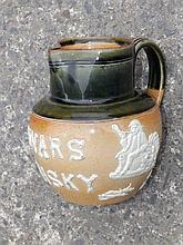 A Royal Doulton stoneware Dewars Whisky hunting jug