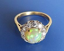 An opal & diamond set 18ct gold cluster ring