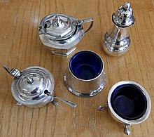 Four silver condiment pieces