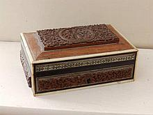 A small Eastern carved wood box
