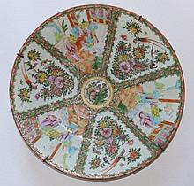 A 19thC Cantonese porcelain charger, painted with typical famille rose panel decoration depicting figures on terraces alternating with flowers, insects and birds – slight chipping to rim, 16""