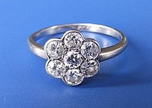 A floral cluster diamond set platinum ring