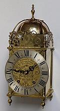 """A 20thC brass lantern style presentation clock with ting-tang striking on a gong 'Presented to Captain & Mrs  Bernard Hedley Charlton...with best wishes of...the Hedley Hope Collieries, County Durham', 15"""""""