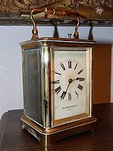 """A repeating brass carriage clock by Sir John Bennett & Co, Paris, 5.5"""" excluding handle – dial cracked"""