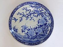 "A blue & white Oriental porcelain charger, decorated birds above a garden,  17"" diameter"