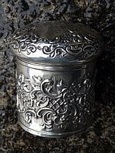 An embossed circular silver dressing table jar – Walter Henry Merle, Birmingham 1897