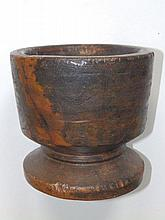 "An antique turned wood mortar, 8"" high"