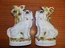 """A pair of Victorian Staffordshire dog spill vases, 13"""" high – one cracked"""