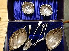 A pair of Chester silver shell salts and one other pair