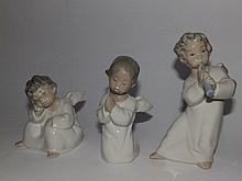 Three small Lladro angels