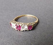 A five stone late Victorian graduated ruby & diamond ring in yellow gold