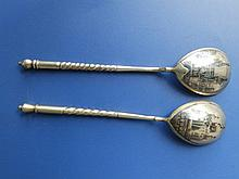 Two Russian silver niello spoons decorated Moscow scenes
