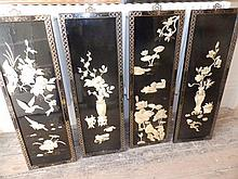 A set of four 20thC Chinese mother-of-pearl inlaid black lacquered panels