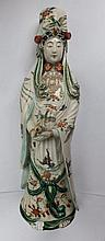 A Chinese porcelain figure of Kuan Yin, decorated in famille verte palette,