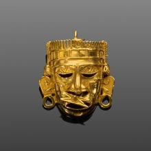 Goldene Aztekenmasken-Brosche.