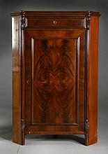 A Continental Flame Grain Mahogany Corner Cabinet