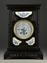 A Delft Ebonized Wood and Porcelain Shelf Clock