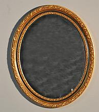 A Gilt Wood And Composistion Oval Mirror