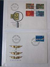 PTT album met  Zwitserse blanco 1ste dag- enveloppen, mooie series, vele met toeslag en speciale zegels