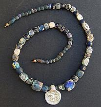 ROMAN IRIDESCENT GLASS NECKLACE & LION PENDANT Roman Period
