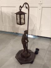 Patinated metal figural table lamp