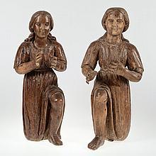 Pair Continental Baroque carved walnut adorants