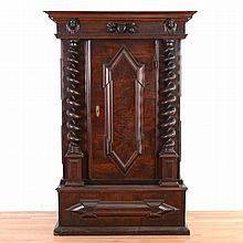 Italian Baroque carved walnut cabinet