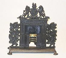 A fine large 1840s English cast iron dolls house Fireplace
