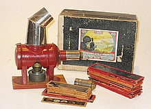 A Bing boxed toy magic lantern and slides,