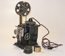 A toy movie projector and three rolls of nitrate film