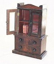 An English 1850s mahogany veneered glazed Bookcase