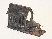 An English Cast iron Donkey and dog in the manger