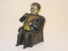 A painted Cast iron Tammany Money Bank,