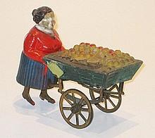 A French Clockwork composition Fruit Vendor, 1930s