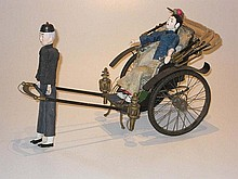 A French tinplate Model Rickshaw with passenger