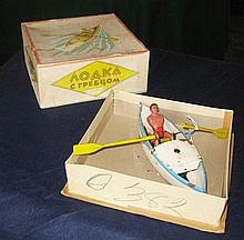 Russian clockwork tinplate Rower, in original box,