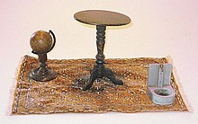 A miniature iron table, rug, water fountain and