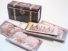 A tin box with a collection of stereo cards, 18cm